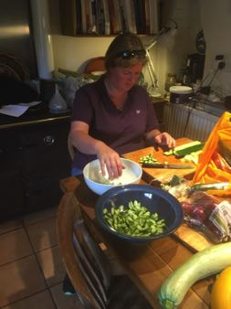 Liz making Greek salad in the kitchen